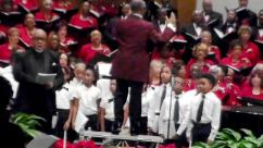 Marco K. Merrick conducts the choir and orchestra.