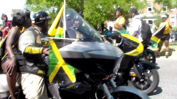 Bikers riding with the Jamaican  flag