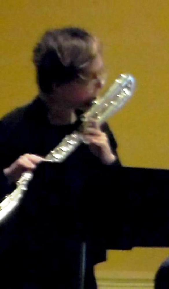 Martha Cargo, playing her bass flute